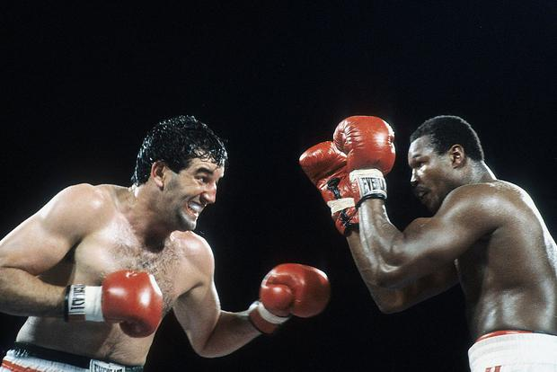 Gerry Cooney (L) looks to throw a punch against Larry Holmes during the fight at Caesars Palace, Outdoor Arena in Las Vegas, Nevada. Larry Holmes won the WBC heavyweight title by a TKO 13. (Photo by: The Ring Magazine via Getty Images)