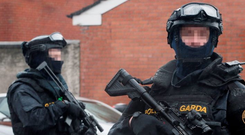 'Can't become complacent': Armed gardaí on patrol in Dublin's north inner city. Photo: Niall Carson/PA Wire