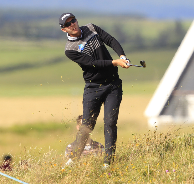Seamus Power plays from the rough on the 14th during yesterday's second round of the Dubai Duty Free Irish Open at Lahinch. Photo: Thos Caffrey / Golffile