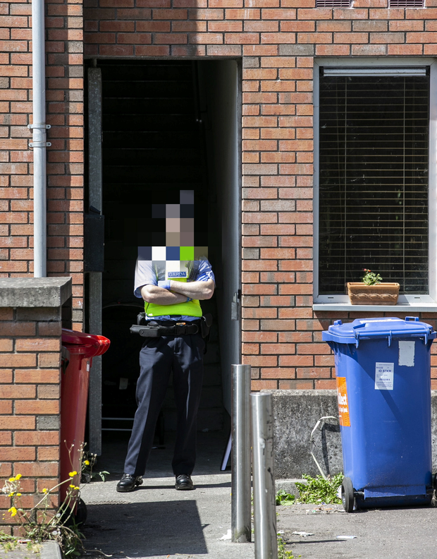 Probe: A garda at the scene of the death of a girl (2) in the Elderwood complex in Co Cork. Photo: Kyran O'Brien