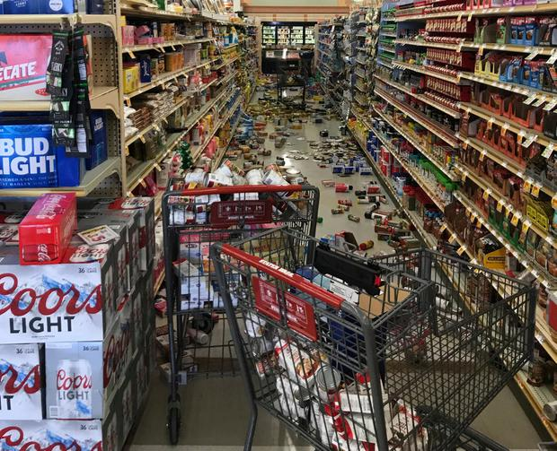 In this photo provided by Adam Graehl, food and other merchandise lies on the floor at the Stater Bros. on China Lake Blvd., after an earthquake, Thursday, July 4, 2019, in Ridgecrest, Calif. (Adam Graehl via AP)