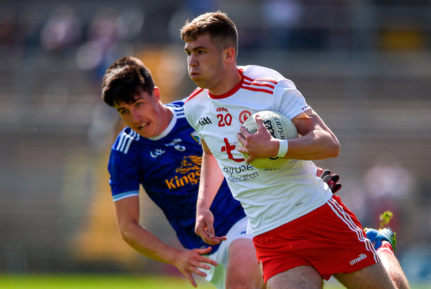 Michael Conroy of Tyrone in action against Cormac Timoney of Cavan