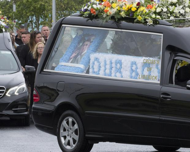 Boxer Kevin Sheehy's funeral arrives at the Holy Family Church, Southill for Requiem Mass this Saturday morning Photograph Liam Burke/Press 22
