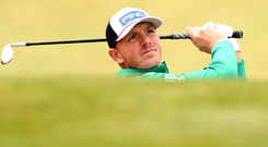 Matt Wallace hits a shot on the second day of the Irish Open at Lahinch. Photo: Reuters/Peter Cziborra