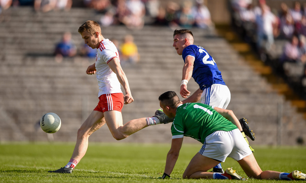 Ben McDonnell of Tyrone shoots to score his side's only goal during yesterday's match against Cavan in Clones. Photo: Ben McShane/Sportsfile