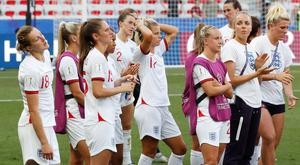 England players look dejected after the match