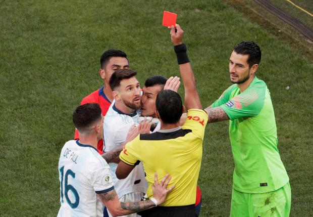 Chile's Gary Medel and Argentina's Lionel Messi are shown a red card by referee Mario Diaz de Vivar