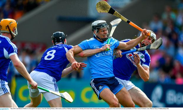 Cian Boland of Dublin in action against Laois players, from left, Pádraig Delaney, John Lennon, and Ryan Mullaney