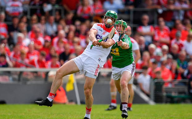 Seamus Harnedy of Cork in action against John Gilligan of Westmeath