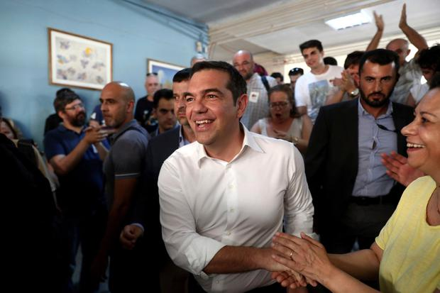 Greek Prime Minister and Syriza party leader Alexis Tsipras greets supporters at a polling station in Athens, on Sunday, July 7, 2019. (AP Photo/Yorgos Karahalis)