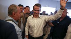 New Democracy conservative party leader Kyriakos Mitsotakis is greeted by supporters as he arrives at the party's headquarters in Athens, Greece July 7, 2019. REUTERS/Costas Baltas