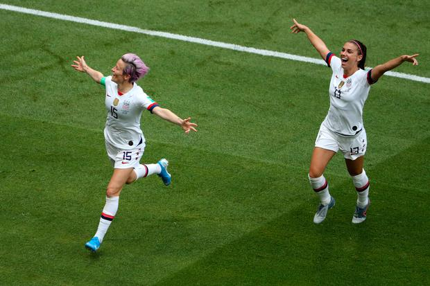 Megan Rapinoe of the USA celebrates with team-mate Alex Morgan after scoring her team's first goal during the 2019 FIFA Women's World Cup final. Photo: Robert Cianflone/Getty Images