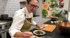 Chef and Plenty advisory board member Nancy Silverton prepares a salad during a demonstration in San Francisco, California, US, June 11, 2019. REUTERS/Jane Lanhee Lee