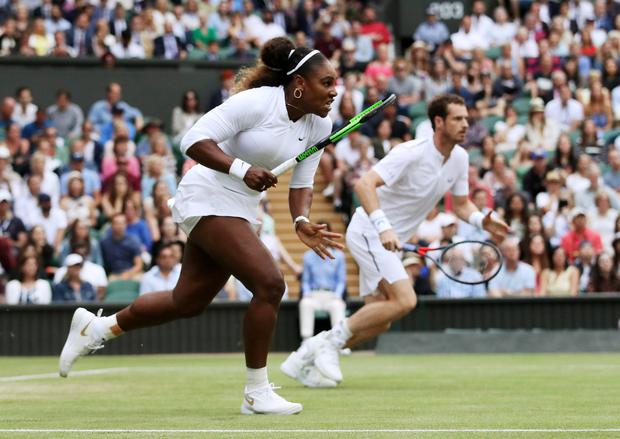 Serena Williams and Andy Murray make their way towards the ball during their mixed doubles victory at Wimbledon. Photo: Reuters