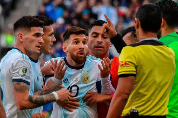 Argentina's Lionel Messi remonstrates with referee Mario Diaz de Vivar after he and Chile's Gary Medel (out of frame) were sent off during his side's 2-1 defeat in the Copa America third-place play-off. Photo: Getty