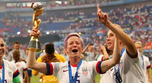 Megan Rapinoe of the US celebrates with the trophy after winning the Women's World Cup following victory over The Netherlands in the Groupama Stadium, Lyon, France. Photo: REUTERS/Denis Balibouse