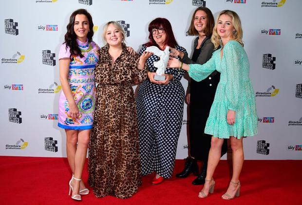 Jamie-Lee O'Donnell, Nicola Coughlan, Louisa Harland and Saoirse-Monica Jackson with producer Liz Lewin (centre) with the Comedy Award for 'Derry Girls'. Photo: Ian West/PA Wire