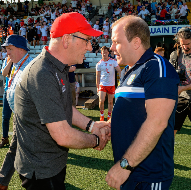 Tyrone Manager Mickey Harte and Cavan Manager Mickey Graham shake hands after the match. Photo by Oliver McVeigh/Sportsfile