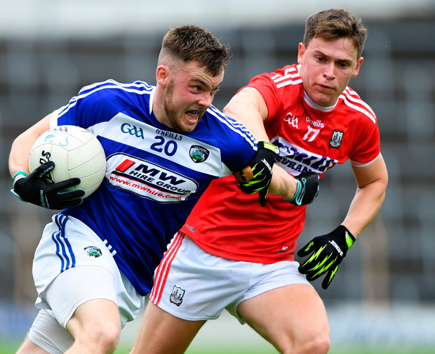 Eoin Lowry of Laois in action against Kevin O'Donovan of Cork. Photo: Matt Browne/Sportsfile