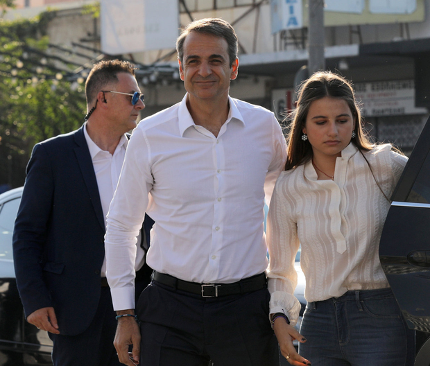 Bound for power: New Democracy leader Kyriakos Mitsotakis arrives with his daughter Dafni at the party's headquarters in Athens after voting. Photo: Reuters/Costas Baltas