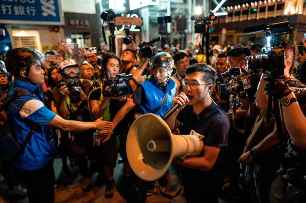 Pro-democracy lawmaker Au Nok Hin uses a loudspeaker in front of police cordon during a rally in Mong Kong district on July 7, 2019 in Hong Kong, China. Over 230,000 people rallied at Kowloon on Sunday as pro-democracy demonstrators have continued on the streets of Hong Kong for the past month, calling for the complete withdrawal of a controversial extradition bill. Photo: Anthony Kwan/Getty Images