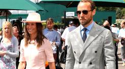 Pippa Matthews (left) and brother James Middleton on day seven of the Wimbledon Championships at the All England Lawn Tennis and Croquet Club, London