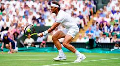 Rafael Nadal in action against Joao Sousa on day seven of the Wimbledon Championships at the All England Lawn Tennis and Croquet Club, Wimbledon. Photo: Adam Davy/PA Wire