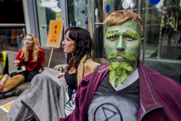 Extinction Rebellion Protestors glue themselves to the entrance. Cormac Nugent. Monday 08 July 2019. Photo: Douglas O'Connor. Dept. of Communication, Climate Action and Environment, Adelaide Rd