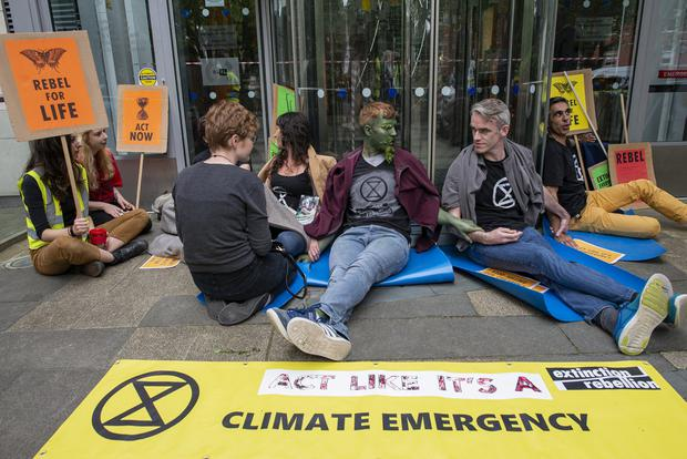 Monday 08 July 2019. Photo: Douglas O'Connor. Dept. of Communication, Climate Action and Environment, Adelaide Rd. Extinction Rebellion Protestors glue themselves to the entrance.