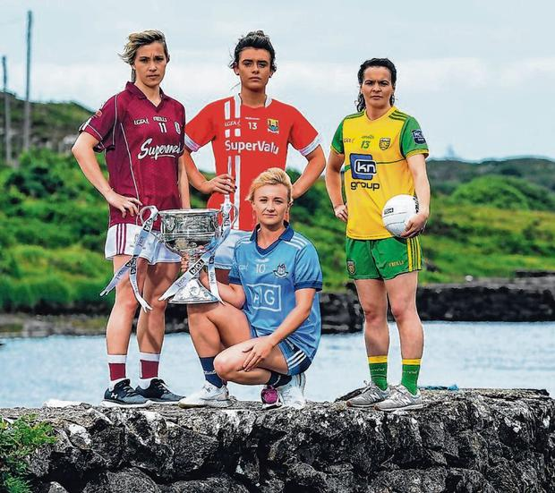 Galway's Tracey Leonard Cork's Doireann O'Sullivan, Dublin's Carla Rowe and Dongel's Geraldine McLaughlin with the Brendan Martin Cup at the Ballynahinch Castle Hotel in county Galway to mark the beginning of the TG4 All-Ireland series. Photo: Brendan Moran/Sportsfile