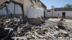 Debris covers the ground after an airstrike at a detention center in Tajoura, east of Tripoli in Libya, on Wednesday. Photo: AP Photo/Hazem Ahmed