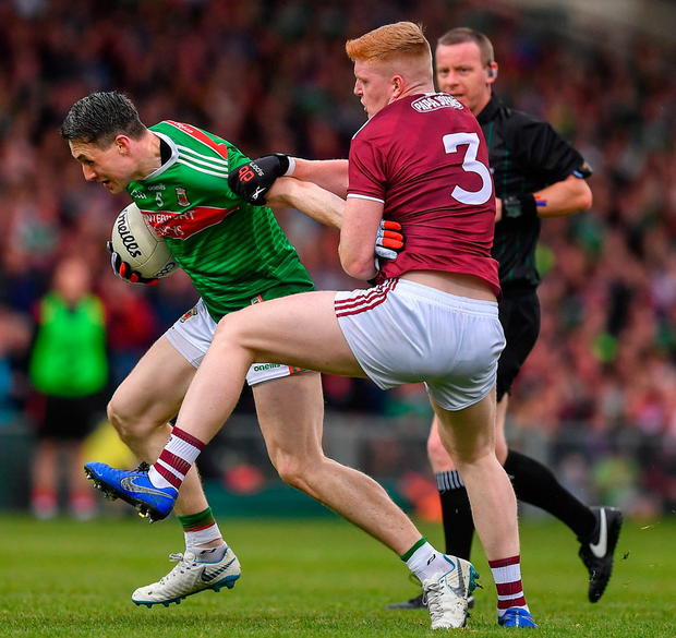 Not so fast: Galway's Seán Andy Ó Ceallaigh gets to grips with Mayo's Paddy Durcan during their qualifier on Saturday. Photo: Brendan Moran/Sportsfile