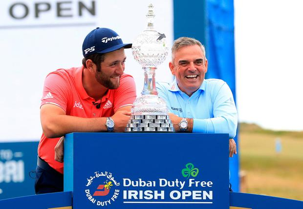 Spain's Jon Rahm with Paul McGinley at the trophy presentation