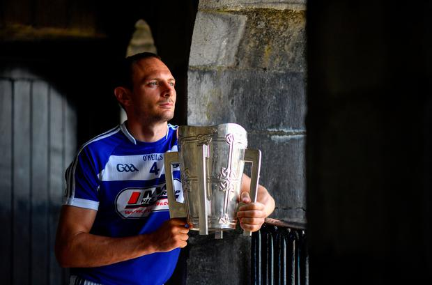 Laois captain Joe Phelan poses with the Liam MacCarthy Cup during the launch of the All-Ireland Senior Hurling Championship series at King's John's Castle in Limerick. Photo: Brendan Moran/Sportsfile