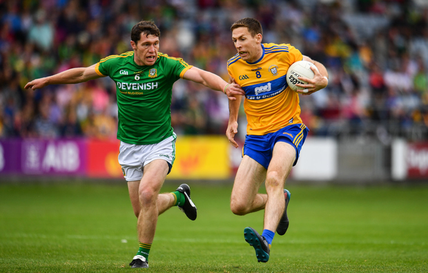 Gary Brennan of Clare in action against Padraic Harnan of Meath during their Round 4 qualifier in Portlaoise last Sunday. Under the proposed new championship structure, Clare would have been forced into Tier 2 this season. Photo by Sam Barnes/Sportsfile