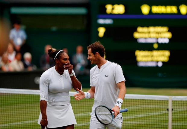 Andy Murray and Serena Williams discuss tactics between points during their 7-5, 6-3 win over France's Fabrice Martin and American Raquel Atawo to seal their place in the last 16 of the mixed doubles at Wimbledon. Photo: AFP/Getty Images