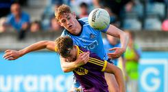 Wexford's Liam Coleman is tackled by Dublin's Peadar O Cofaigh Byrne during the EirGrid Leinster U-20 FC semi-final at Parnell Park. Photo: Eóin Noonan/Sportsfile