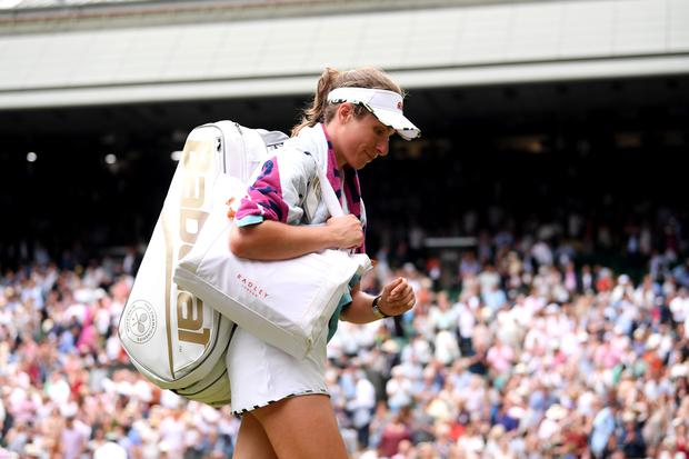 LONDON, ENGLAND - JULY 09: Johanna Konta of Great Britain walks off the court following defeat in her Ladies' Singles Quarter Final match against Barbora Strycova of Czech Republic (Photo by Laurence Griffiths/Getty Images)
