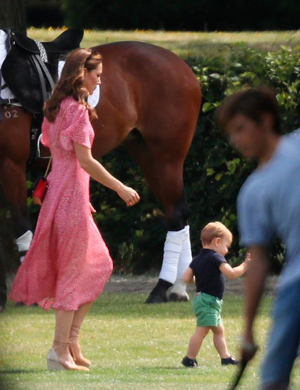 The Duchess of Cambridge and Prince Louis attend the King Power Royal Charity Polo Day at Billingbear Polo Club, Wokingham, Berkshire