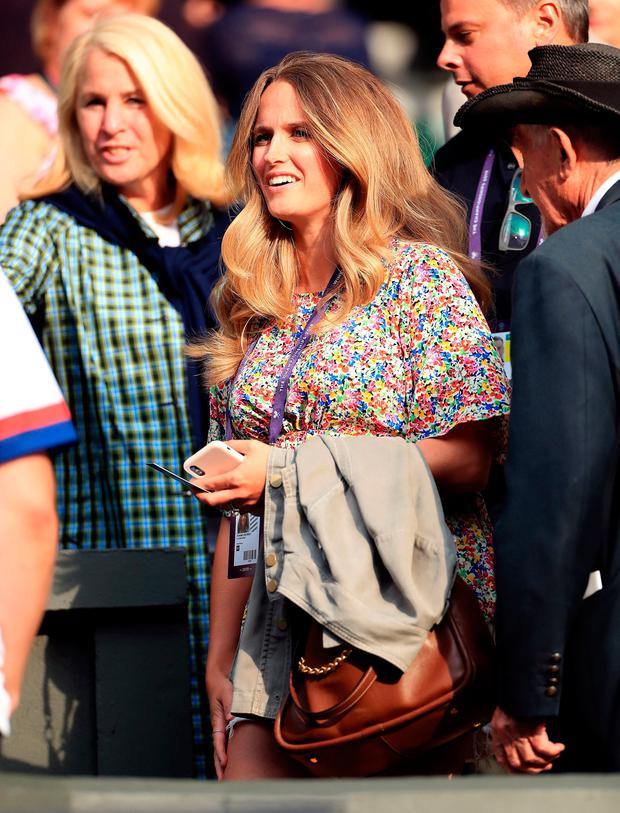 Kim Murray watches Andy MurrayÄôs mixed doubles match on day six of the Wimbledon Championships at the All England Lawn Tennis and Croquet Club, Wimbledon