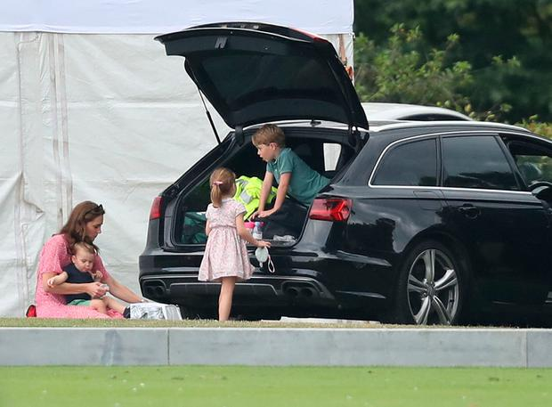 The Duchess of Cambridge, Prince George, Princess Charlotte and Prince Louis attend the King Power Royal Charity Polo Day at Billingbear Polo Club, Wokingham, Berkshire