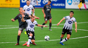 John Mountney of Dundalk in action against Tomislav Saric of Riga during the UEFA Champions League First Qualifying Round 1st Leg match between Dundalk and Riga at Oriel Park in Dundalk, Co Louth. Photo: Eóin Noonan/Sportsfile