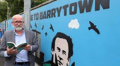 10/07/'19 Author Roddy Doyle pictured this morning at Kilbarrack DART Station for the launch of two new murals, created by members of the Reach out Project, which is a programme run by Kilbarrack Costal Programme. It is designed to help 18 to 25 year olds from the area, who are struggling with a variety of psychosocial pressures such as addiction or mental health conditions..Picture Colin Keegan, Collins Dublin