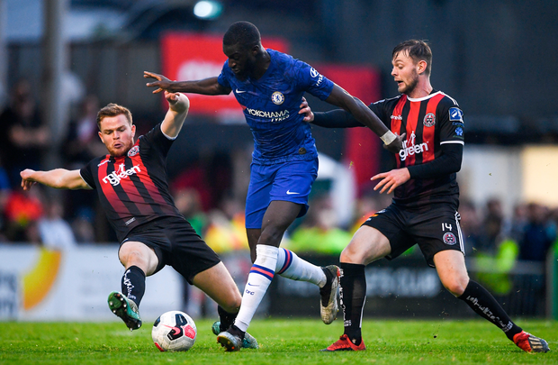 Chelsea's Tiemoue Bakayoko is tackled by Bohemians' Alex Kelly (l) and Conor Levingston during their friendly at Dalymount Park last night