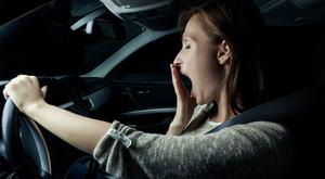 Adapting: Thanks to AI technology, a car will lower the temperature if it sees a driver yawning. Stock Image
