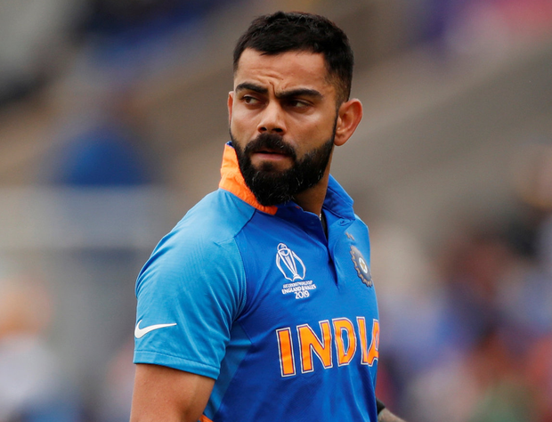 India's Virat Kohli reacts after losing his wicket. Photo: Reuters/Lee Smith