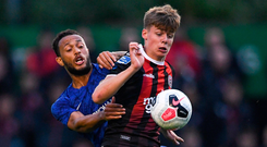 Fourteen-year-old Evan Ferguson, son of former League of Ireland player Barry, holds off Lewis Baker during Bohemians' friendly against Chelsea at Dalymount Park last night. Photo: Ramsey Cardy/Sportsfile
