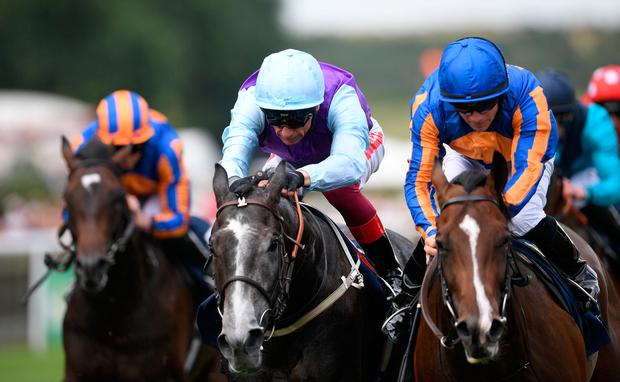 Royal Lytham ridden by jockey Wayne Lordan (right, blue and orange) coming home to win the Tattersalls July Stakes during day one of the Moet and Chandon July Festival 2019 at Newmarket Racecourse. Joe Giddens/PA Wire