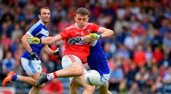 Mark Collins of Cork scores the third goal past Laois defender Trevor Collins during the GAA Football All-Ireland Senior Championship Round 4 match between Cork and Laois at Semple Stadium in Thurles, Tipperary. Photo by Matt Browne/Sportsfile