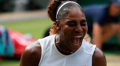 Serena Williams celebrates during the women's singles semi final match on day ten of the Wimbledon Championships at the All England Lawn Tennis and Croquet Club, London. Steven Paston/PA Wire